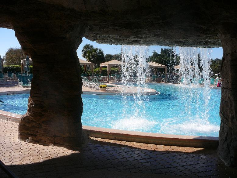 The Country Club pool at the Villages of Orange Blossom Gardens, The Villages, Florida 32159.  View through the waterfall.