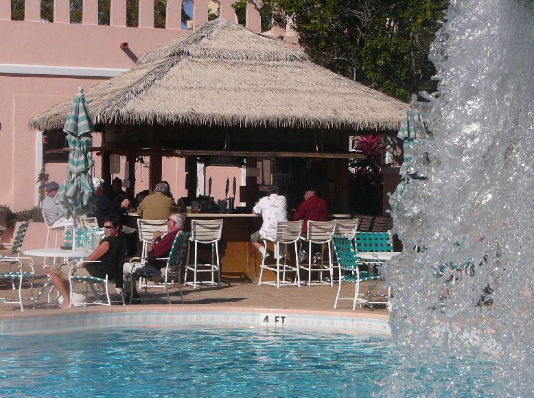 The Tiki Bar at the Country Club pool at the Villages of Orange Blossom Gardens, The Villages, Florida 32159.  Waterfall is on the right.